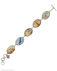 Wear your wanderlust on your wrist! Howlite, Paper, Glass, Sterling Silver. Toggle Clasp.