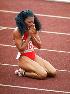 Florence Griffith Joyner, also known as Flo-Jo, was an American Olympic track… Flo Jo, American Athletes, Female Athletes, Women Athletes, Poses, Olympic Track And Field, Track Field, Sport Icon, Fit Chicks