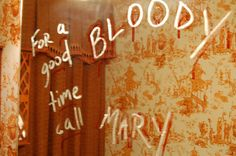 Bloody Mary message on bathroom mirror