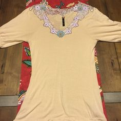 Size small Free People blouse Cream colored with beautiful embroidery flower detail around the neckline. Such a cute shirt. Just a little too small for me. Free People Tops Blouses