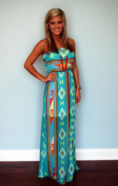 We know you'll love this colorful Aztec maxi dress. The chest band and waist band are elastic for your best fit. Model is 5'3 and wearing a small.