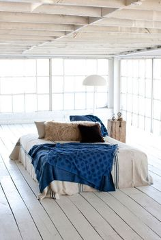 white indigo blue natural bedroom Jill Sharp Brinson.~love the bed floating in the room