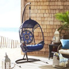 """With a throne-like appearance, our Blue Medallion Swingasan® has open sides and a large flower medallion on the back. Made of weather-resistant, synthetic rattan over a rust-resistant, wrought iron frame. It's the perfect place for the resident queen, king, princess—well, you get the idea. Swingasan® Stand sold separately.<span id=""""mini-upsell"""" data-launch=""""true"""" data-required=""""false"""" data-product=""""Cushions"""" data-masters=..."""
