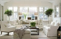 White Living Room with green topiary