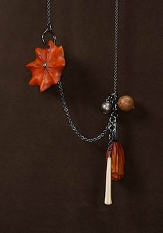"Sharon Church, Totem Necklace in carved, dyed and painted castello boxwood; cherry branch, rose-cut diamond, cork core of an old baseball and oxidized sterling silver elements. 48"" in length."