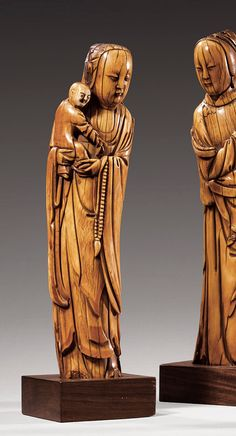 A CARVED IVORY FIGURE OF A GUANYIN AND A CHILD, CHINA, MING DYNASTY, 17TH CENTURY