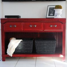 A three drawer wood dresser was converted into a beautiful red console by removing the bottom drawers and finishing with stain over paint.