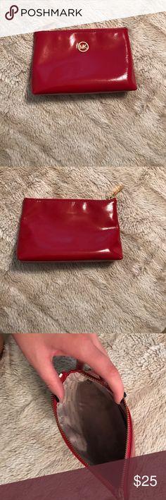 Michael Kors leather mini bag This is a super cute shiny, leather MK makeup or mini bag! Michael Kors Bags Mini Bags