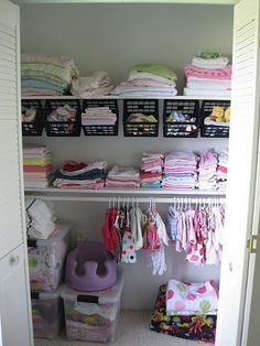 great space saving idea for the closet using plastic crates on hooks!