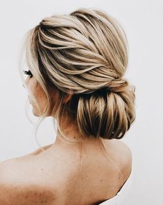 Simple chic bridal chignon.