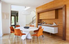 Modern dining room design with white and grain matched wood | Los Altos House by Dotter Solfjeld Architecture