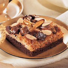 "You will find that these brownies are llike ""mounds"" of goodness in your mouth! Coconut+Almond+Brownie+Squares+-+The+Pampered+Chef® Like my Facebook page for even more recipe ideas: www.facebook.com/jennifermentingspamperedchefpage"