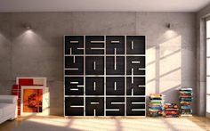 The book case is constructed to look like letters, an interesting design.  I would like to see some color in there as well because the black almost leaves this black hole feeling.
