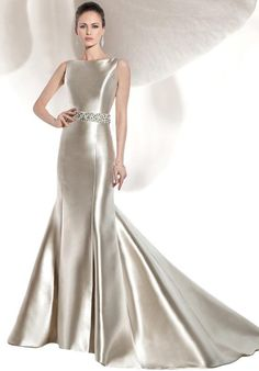 Micado Satin, Sleeveless, fit n flare with a low V-back.  Gown features buttons throughout entire back and attached Chapel train.  Jeweled belt – style BL44 – Sold separately.