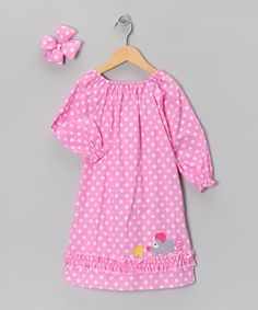 There's nothing quite as adorable as a girl in a peasant dress, with its gathered elastic neckline showcasing rosy little cheeks. A cushy coordinating bow finishes the look like a cherry on top!