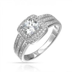 If the lady you are in love with loves to sparkle and shine, then you should consider our sensational triple shank square sterling silver cubic zirconia ring when you prepare to get down on one knee. A X square cut clear CZ stone is prong set with Round Halo Engagement Rings, Cubic Zirconia Engagement Rings, Engagement Wedding Ring Sets, Silver Wedding Rings, Bling Jewelry, Jewelry Rings, Jewellery, 925 Silver, Accessories