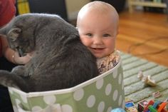 A baby who is incredibly happy about the cat situation. | 41 Pictures You Need To See Before The Universe Ends