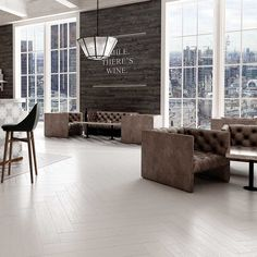 Quickly inject a relaxing spa styled natural scheme into your home with these Tavern White Wood Tiles. These porcelain planks can be used on a wall or floor. White Bathroom Tiles, White Tiles, Wood Effect Tiles, Wood Tiles, Black And White Style, White Wood, Plank, Tile Floor, Kitchen Design