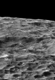 NASA's Cassini spacecraft gazes out upon a rolling, cratered landscape in this oblique view of Saturn's moon Dione.