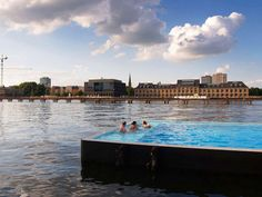 The Badeschiff, in Berlin, is a public pool on a barge in the River Spree, overlooking the city. During the winter, the pools are covered so swimming can continue year-round. Image from Arsema. Entry is only 4 euros.