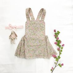 A N N A dress with the sweetest little @mailegworld bunny and pretty bow   #cocoandwolf #girlsstyle #pinaforedress #libertyprintloveliness #maileg #microbunny