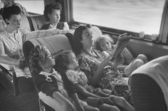 "A mother reads her children the comics while traveling on the ""El Capitan"" train between Chicago and Los Angeles, 1945. Sam Shere—Time & Life Pictures/Getty Images"