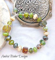 Green stone and Czech glass bracelet, silver metal, gemstone stretch cord, wrist jewelry.