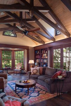 Check out this craftsman living space with brown scissor trusses and traditional furnishings on HGTV.com.