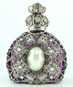 very antique perfume bottles | photo bd54c579-71e3-40c8-acf6-085a3d26fd74_zpseee79688.jpg