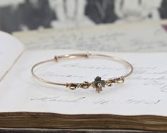 Victorian Bracelet, Antique 10k Bi Color Gold with Platinum Accents & Old Mine Cut Diamond, Sweetheart Love Token Flower Stacking Bangle by TheEdenCollective on Etsy https://www.etsy.com/listing/196839194/victorian-bracelet-antique-10k-bi-color