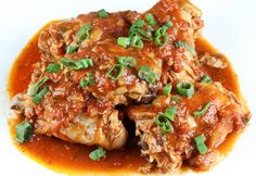 Chicken in spicy tomato sauce,, might also be good to make a little more saucy with chicken cut to bite size mixed in sauce and served over rice...