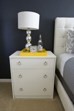 use a decorative tray for the bedside essentials