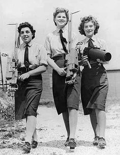 World War 2: Three members of WAAF, (Women's Auxiliary Air Force), equipped with camera guns and aerial camera for overhaul at the School of Instrument and Repairers and Cine Projectionists. Circa 1943.