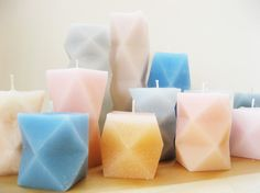 These geometric candles are surprisingly easy - the molds are made by cutting, folding, and gluing paper, and the project includes 7 free templates.