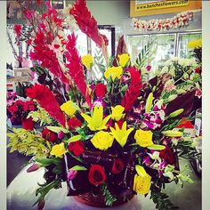 #HUGE! #Roses, #lilies, #orchids, #ginger and more! A fun, front-facing arrangement in a basket!