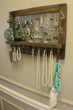 Recycled peg board jewelry hanger
