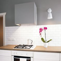 modern kitchen with grey wall and new rangehood