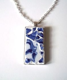 Broken Dish Mosaic Pendant in popular blue and white with blue bird of happiness. Pendant measures 2 inches. Silver plated.  Appropriate for any age from pre-teen to grandmother.  Comes with a silver linked chain necklace measuring 12 inches.  Pendant is wrapped in tissue paper and placed i...