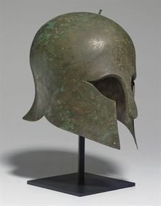 A Greek Corinthian bronze helmet, Archaic period, circa century B. Helmet Armor, Arm Armor, Greek History, Ancient History, Ancient Greek Clothing, Greek Helmet, Corinthian Helmet, Ancient Armor, Knight Armor
