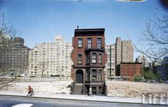 """""""newoldyork:  """"Construction in NYC: land being cleared for 20 story building in East 60s — still occupied brownstone is soon to go."""" from LIFE Magazine  """""""
