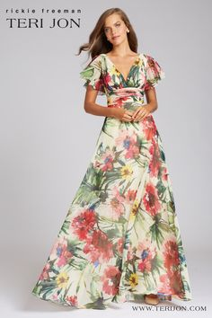 Perfect for a cocktail event or outside wedding, this floral gown is both flattering and fun. The V-neck makes this gown perfect for your Spring/Summer events! Backyard Wedding Dresses, Backyard Weddings, Floral Gown, Summer Events, Outside Wedding, Mother Of The Bride, Bride Groom, Party Wear, Short Sleeve Dresses