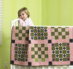 Vintage Baby Quilt - Make this crib quilt in no time with quick strip piecing and rotary cutting techniques. Light pink fabric mixed with subdued greens and blues gives this quilt a vintage feel. Get instructions for the vintage baby quilt. Quilt Baby, Baby Quilt Patterns, Baby Girl Quilts, Girls Quilts, Children's Quilts, Quilting Patterns, Quilts For Kids, Patchwork Quilting, Block Patterns