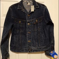 vintage Lee denim jean jacket Still has tags !!! This is a true vintage lee jean jacket. The original tags are still attached and jacket is in mint nwt condition. Tagged a size 16 but is a medium in today's sizes. It is Rare to find a jacket of this age and quality nwt great find!! :) Lee Jackets & Coats Jean Jackets