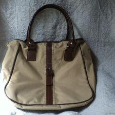 Vinyl tote bag Tan vinyl tote bag. Has one zippered pocket inside. Very roomy. Washable. Bags Totes