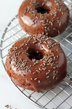 Chocolate Sour Cream Donuts - Soft, super chocolatey sour cream donuts are baked up to pure perfection before taking a dunk in a rich, chocolate glaze! Chocolate lovers – these are sure to be a new favorite!