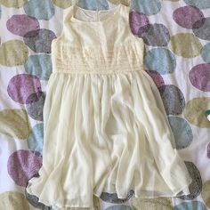 Off white summer dress Perfect summer dress. Off white color. 100% cotton bodice with details. 100% polyester skirt for floaty effect. Zipper in the back for closure. Excellent condition. Shulami Dresses