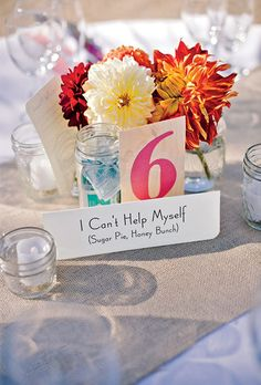 Each table displayed a song title; when the DJ played that tune, it was the cue for those guests to get on the buffet line. #weddingideas