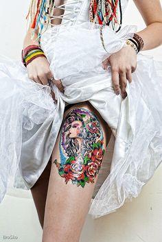 girls thigh tattoo