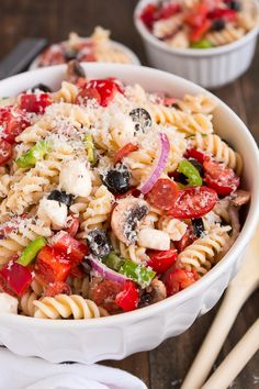Serve Pizza Pasta Salad at your next barbecue and enjoy the delicious flavors of an Everything Pizza in this veggie, pepperoni, and cheese filled side dish. ohsweetbasil.com