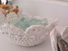 doily bowl: mix plaster of paris with water, cover doily with mixture, place over bowl and let dry